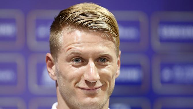 A.C. Milan soccer player Ignazio Abate attends a news conference ahead of a friendly match against Real Madrid in Shanghai