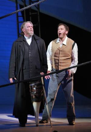 "In this photo taken Oct. 1, 2012 and provided by the San Francisco Opera, Jay Hunter Morris, portraying Captain Ahab, left, and Morgan Smith, portraying Starbuck, perform the opera Moby Dick in San Francisco. ""Moby-Dick,"" a hit at its premiere in Dallas in 2010 and successfully revived several times since, benefits from a savvy libretto by Gene Scheer, which boils down Melville's sprawling novel to a coherent narrative, while maintaining chunks of his poetic language. (AP Photo/San Francisco Opera, Cory Weaver)"