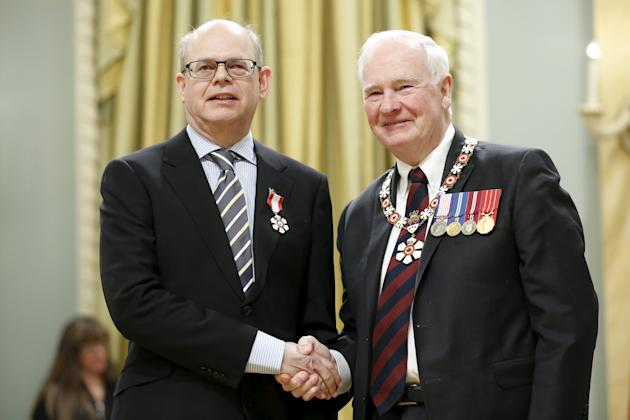 Research In Motion (RIM) co-founder Douglas Fregin (L) poses with Governor General David Johnston after being awarded the rank of Member in the Order of Canada during a ceremony at Rideau Hall in Ottawa, Canada, February 12, 2016. REUTERS/Chris Wattie