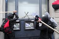 Protesters attack an ATM during a mass demonstration against government financial cuts in central London in 2011. European Union finance ministers struggled Wednesday to reach a deal on rules to shelter banks from future crises, as Britain and Sweden fought for the power to impose tougher defences