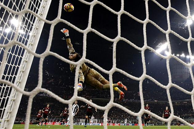 AC Milan's goalkeeper Gianluigi Donnarumma saves a goal during the match against Juventus on October 22, 2016 at the San Siro Stadium