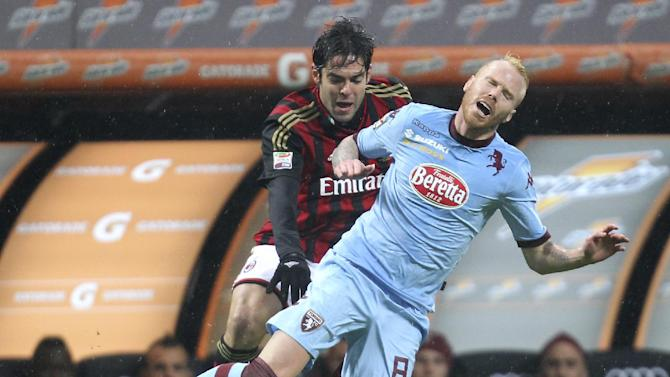 AC Milan Brazilian forward Kaka, left, challenges for the ball with Torino midfielder Alexander Farnerud, of Sweden, during the Serie A soccer match between AC Milan and Torino at the San Siro stadium in Milan, Italy, Saturday, Feb. 1, 2014
