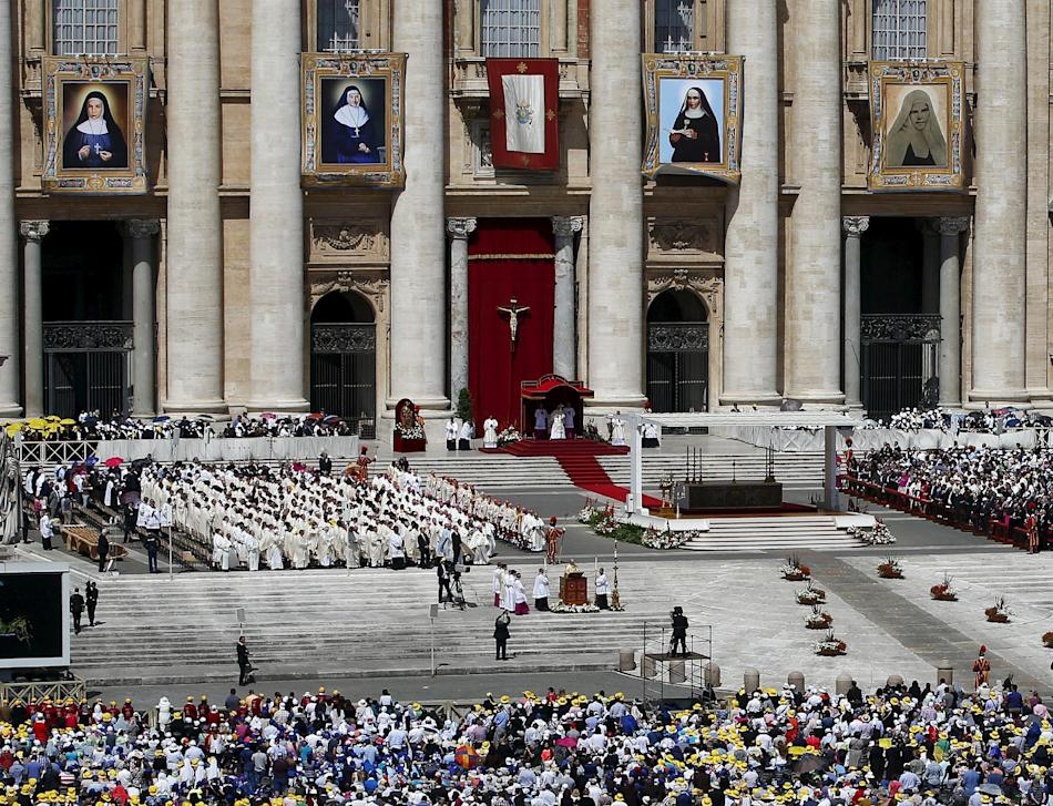Tapestries of four nuns are pictured in St.Peter's square as Pope Francis leads a ceremony for the canonisation in the Vatican City