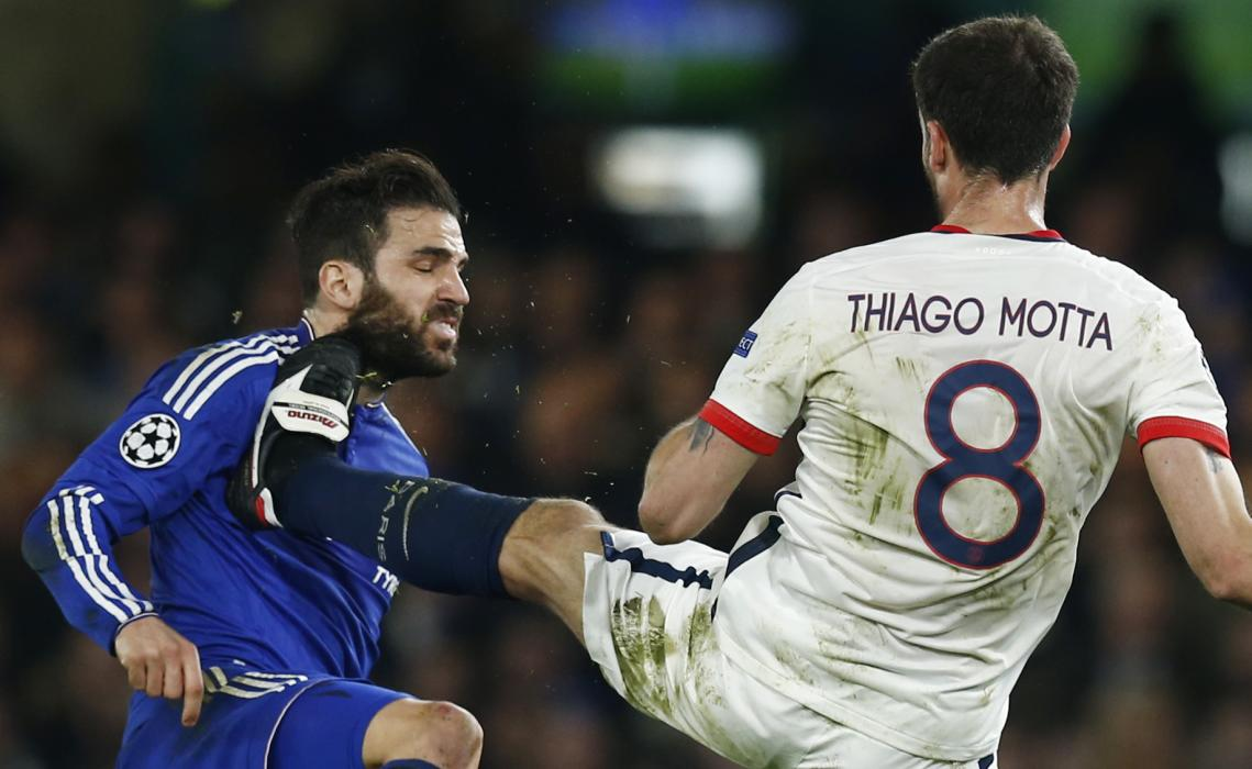 PSG's Thiago Motta in action with Chelsea's Cesc Fabregas