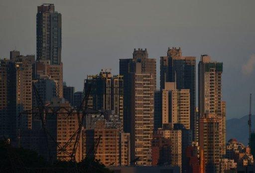 The sun reflects off residential buildings in Hong Kong