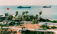 This photo released by the Military Information Agency in Taiwan shows two Taiwanese warships docking near the shore of Taiping Island, the largest of the disputed Spratly Island chain in 1995. Taiwan's defence ministry said Wednesday that it has formed a special airborne unit capable of scrambling to the contested Spratly islands in just hours, as tensions in the South China Sea mounted