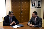 Greek Prime Minister Antonis Samaras (left) and Finance Minister Yannis Stournaras hold a meeting at the Finance Ministry in Athens on August 8. Greece's finance minister said Wednesday the outline of a 11.5 bn euro savings package needed to unlock EU-IMF bailout loans has been agreed, but coalition parties said cuts remain to be decided