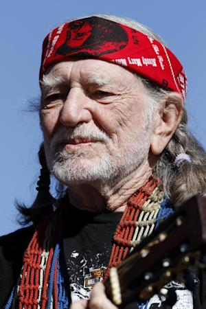 FILE - In this Nov. 7, 2010 file photo, Willie Nelson performs before the start of the NASCAR AAA Texas 500 auto race at Texas Motor Speedway, in Fort Worth, Texas. Nelson is sending out his prayers via Twitter Thursday April 18, 2013 after a deadly fertilizer plant explosion rocked West, Texas, a small community north of Waco near where he grew up. He was born and grew up 120 miles north of the state capital, in tiny Abbott, which is about five miles north of West. (AP Photo/Tim Sharp, File)