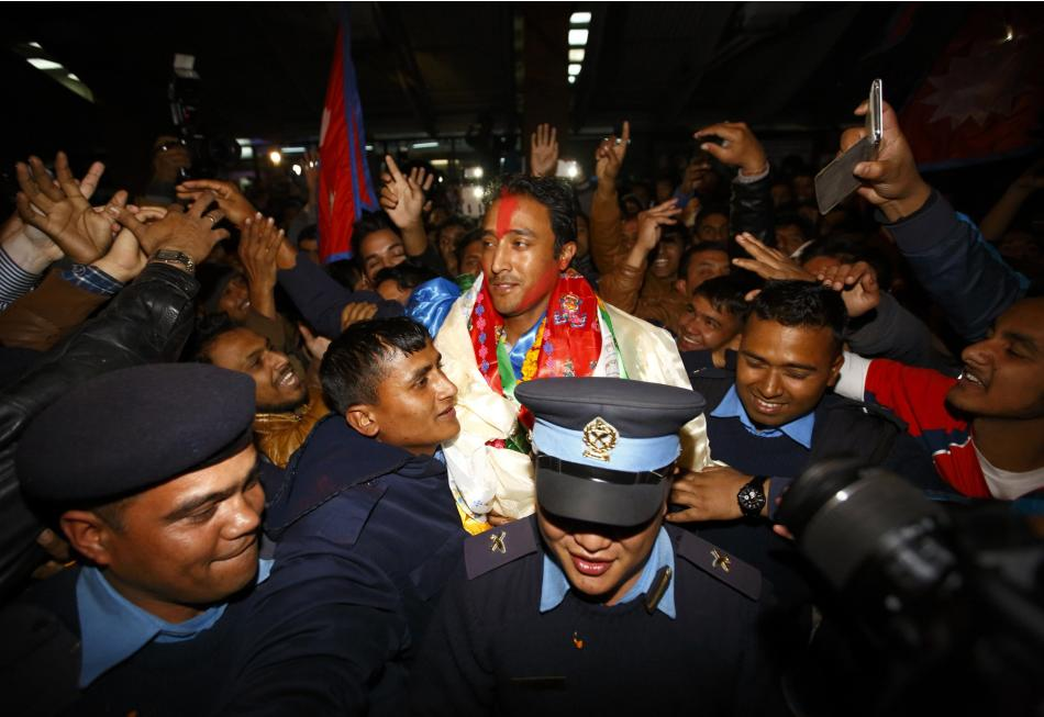 Captain of Nepali national cricket team Paras Khadka is given a hero's welcome by Nepali supporters upon the team's arrival at the airport after qualifying for the first time in ICC World Twenty20 cri