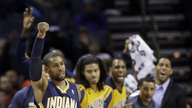 Indiana Pacers' C.J. Watson (32) celebrates after making a 3-point shot against the Charlotte Bobcats during the second half of an NBA basketball game in Charlotte, N.C., Wednesday, Nov. 27, 2013. The Pacers won 99-74
