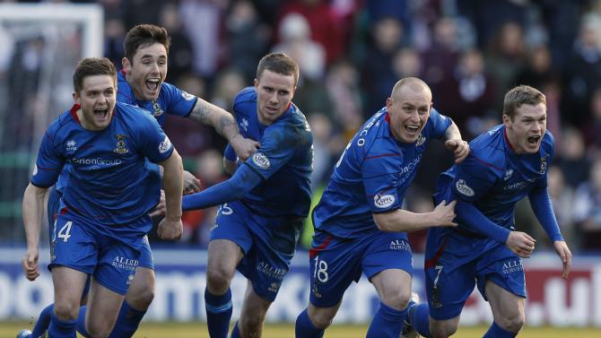 Inverness Caledonian Thistle's players Devine, Tansey, Watkins, Tremarco and McKay celebrate the winning penalty against Hearts during their Scottish League Cup semi final soccer match in Edinburgh