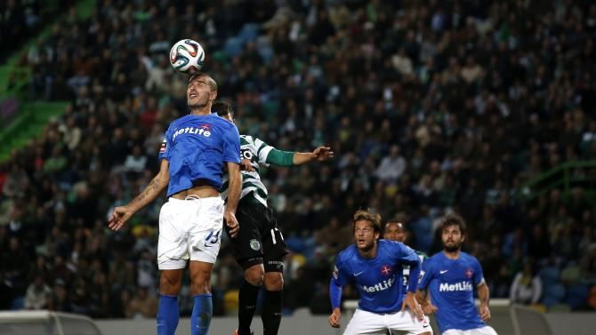 Sporting's Montero heads for the ball with Belenenses' Afonso during their Portuguese Premier League soccer match in Lisbon