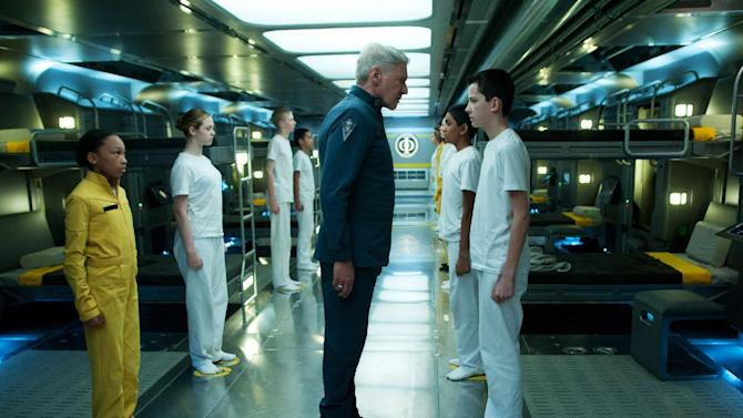 "This publicity photo released by Summit Entertainment shows Harrison Ford, center, and Asa Butterfield, right, in a scene from the film, ""Ender's Game."" (AP Photo/ Summit Entertainment, Richard Foreman Jr., SMPSP)"