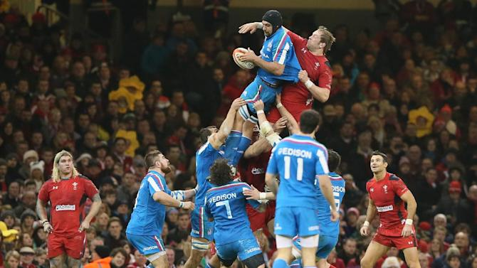 Italy's Marco Bortolami, collects the ball during a line out during their Six Nations international rugby union match between Wales and Italy at the Millennium stadium in Cardiff, Wales, Saturday, Feb. 1, 2014