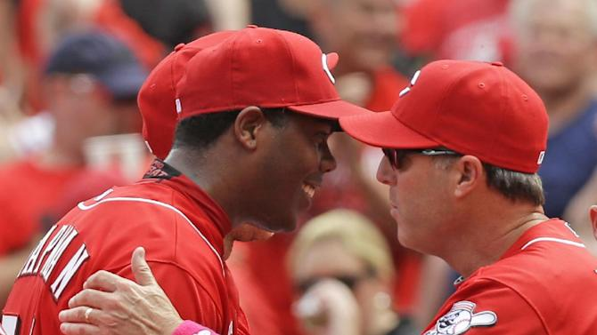 Frazier, Bailey lead Reds to 4-1 win over Rockies