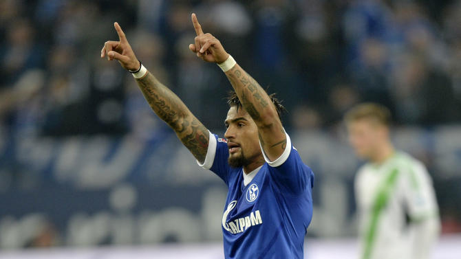 Schalke's Kevin-Prince Boateng of Ghana celebrates after scoring his side's second goal during the German Bundesliga soccer match between FC Schalke 04 and VfL Wolfsburg in Gelsenkirchen,  Germany, Saturday, Feb. 1, 2014