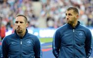 French forwards Franck Ribery (L) and Karim Benzema look on prior to a friendly football match against Uruguay at the Oceane stadium in Le Havre, western France. The match ended in a 0-0 draw