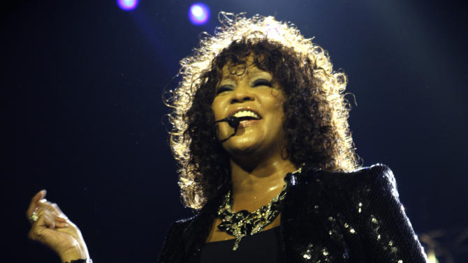 FILE - In this April 25, 2010 file photo, singer Whitney Houston performs at the o2 in London as part of her European tour. An autopsy report shows that cocaine was found in Houston's system and that investigators recovered whity powdery substances from her hotel room.  Houston died Feb. 11, in California at the age of 48. (AP Photo/Joel Ryan, file)
