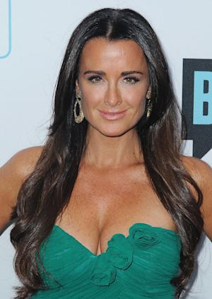 "FILE - In this March 30, 2011 file photo, TV personality Kyle Richards arrives at the Bravo Media's 2011 upfront presentation at The Roosevelt Hotel in Los Angeles. ""The Real Housewives of Beverly Hills"" star, mother of four girls and wife of 17 years doles out her brand of no nonsense advice on relationships, fashion and beauty in her new book, ""Life Is Not a Reality Show: Keeping It Real with the Housewife Who Does It All."" (AP Photo/Katy Winn, file)"