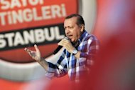 Turkish Prime Minister Recep Tayyip Erdogan makes a speech to his supporters during a rally on June 16, 2013 in Istanbul. Opponents accuse Erdogan of authoritarian tendencies and of forcing Islamic conservative reforms on the mainly Muslim but staunchly secular nation of 76 million