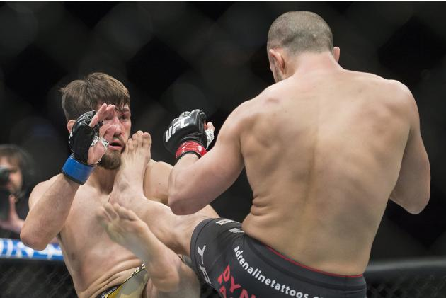 Chad Laprise, right, from Canada, lands a kick to the head of Bryan Barberena, from the United States, during their UFC 186 mixed martial arts lightweight fight in Montreal, Saturday, April 25, 2015.