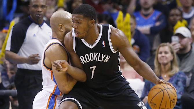 Brooklyn Nets guard Joe Johnson (7) drives against Oklahoma City Thunder guard Derek Fisher during the third quarter of an NBA basketball game in Oklahoma City, Thursday, Jan. 2, 2014. The Nets won 95-93