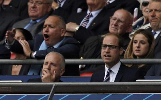 Aston Villa owner Randy Lerner (L) and Britain's Prince William watch the FA Cup final football match between Aston Villa and Arsenal at Wembley stadium in London on May 30, 2015