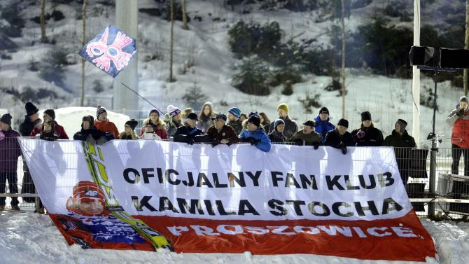 Fans of Poland's Kamil Stoch display a banner during the Ski Jumping Large Hill FIS World Cup in Kuopio