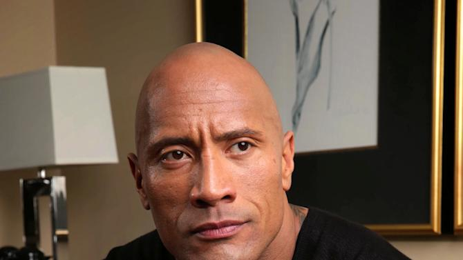 "In this Saturday, March 23, 2013 photo, Dwayne Johnson poses for a portrait at the Four Seasons in Los Angeles. The 40-year-old actor has become a savior of stale film series, injecting new life into ""Fast Five,"" ""The Mummy Returns,"" ""Journey 2: The Mysterious Island"" and now ""G.I. Joe: Retaliation.""  (Photo by Eric Charbonneau/Invision/AP)"