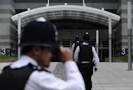 File photo of police outside the offices of News International in London. British police investigating phone hacking at Rupert Murdoch's News of the World arrested the former chief reporter of the tabloid for allegedly intimidating a witness