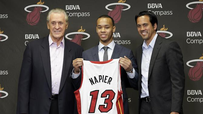 Miami Heat President Pat Riley, left, Shabazz Napier, center, and head coach Erik Spoelstra pose for photos at a news conference in Miami, Monday, June 30, 2014. The Heat acquired the draft rights to Connecticut guard Shabazz Napier in a trade with the Charlotte Hornets on Thursday night, giving up the 26th and 55th picks to make the deal happen, along with a future second-round choice and cash considerations