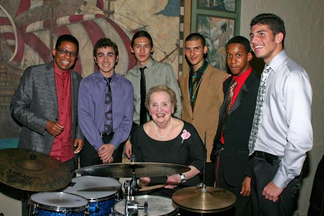 In this 2011 photo provided by The Monk Institute, former U.S. Secretary of State Madeleine Albright, center, poses for a photo with Herbie Hancock, far left, and New World School of the Arts students