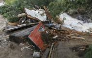 A destroyed house lies piled up against a tree in Jamestown, Colorado, after a flash flood destroyed much of the town, September 14, 2013. REUTERS/Rick Wilking