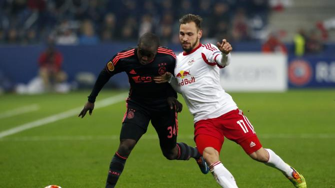 Salzburg's Ulmer fights for ball with Ajax Amsterdam's Sa during Europa League soccer match in Salzburg