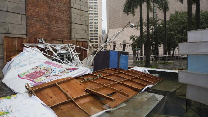 An advertisement board which was toppled over by Typhoon Usagi is pictured in Hong Kong
