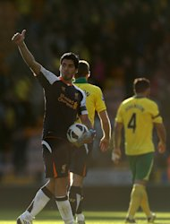 Luis Suarez celebrates his hat-trick against Norwich