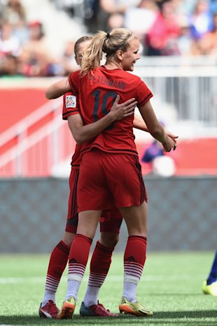 WINNIPEG, MB - JUNE 15: Lena Petermann of Germany celebrates with team mates as she heads the second goal during the FIFA Women's World Cup Canada 2015 Group B match between Thailand and Germany at Winnipeg Stadium on June 15, 2015 in Winnipeg, Canada. (Photo by Dennis Grombkowski/Bongarts/Getty Images)