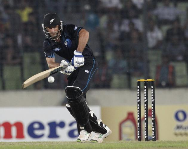 New Zealand's Grant Elliott plays a shot against Bangladesh during their first ODI cricket match in Dhaka