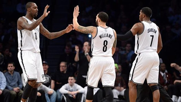 Brooklyn Nets center Andray Blatche (0) and Brooklyn Nets point guard Deron Williams (8) and Brooklyn Nets shooting guard Joe Johnson (7) celebrate