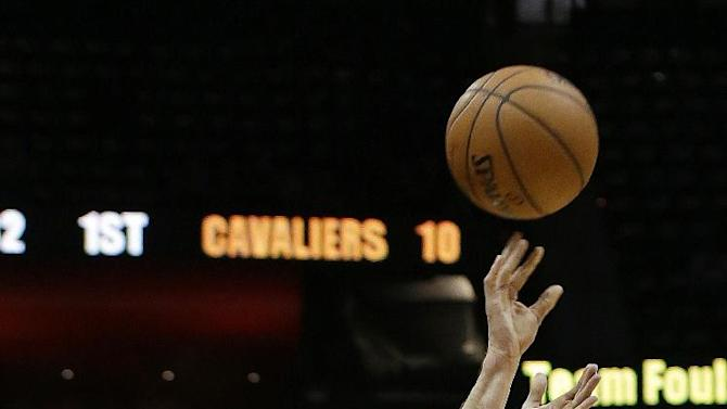 Atlanta Hawks' Kyle Korver sinks a three-point basket in the first half of an NBA basketball game against the Cleveland Cavaliers to break the NBA record for most consecutive games with a three pointer Friday, Dec. 6, 2013, in Atlanta. The old record was 89 straight games held by Dana Barros