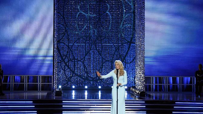 Miss Tennessee Chandler Lawson competes in the talent portion of the Miss America 2013 pageant on Saturday, Jan. 12, 2013, in Las Vegas. (AP Photo/Isaac Brekken)