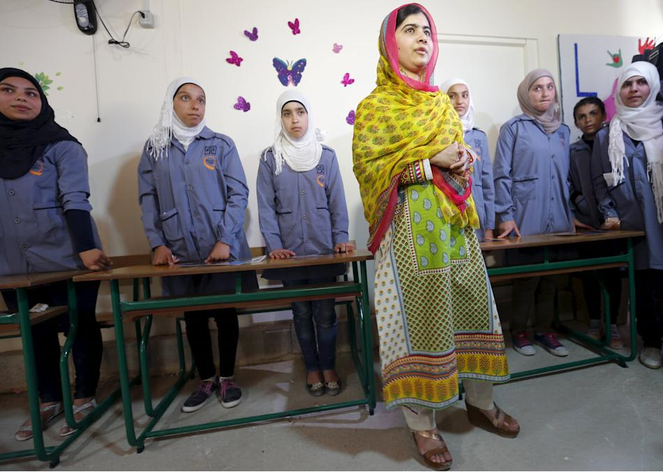 Nobel Peace Prize laureate Malala Yousafzai stands with girls inside a classroom at a school for Syrian refugee girls, built by the NGO Kayany Foundation, in Lebanon's Bekaa Valley