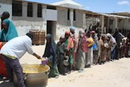 Somali children receive food ration at a feeding center in the southern Mogadishu district of Howlwadag in April. Anti-poverty campaigners are urging leaders of rich nations to commit at a weekend summit to feeding the world's poor, warning that hunger is taking a devastating toll away from the headlines