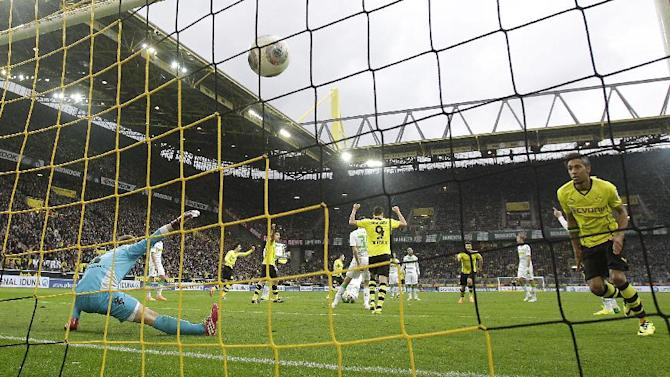Dortmund's Milos Jojic of Serbia, third from right, scores during the German first division Bundesliga soccer match between BvB Borussia Dortmund and VfL Borussia Moenchengladbach in Dortmund, Germany, Saturday, March 15, 2014