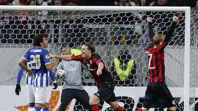 Frankfurt's Alexander Meier , center, celebrates his side's third goal during a Europa League round of 32 second leg soccer match between Eintracht Frankfurt and FC Porto in Frankfurt, Germany, Thursday, Feb. 27, 2014