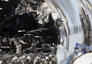 Burned seats are visible in the wrecked fuselage of Asiana Airlines flght 214 as it sits in a storage area at San Francisco International Airport on July 12, 2013. A third girl, reportedly Chinese, died of injuries sustained in the Asiana jet crash in San Francisco, as authorities confirmed that a firetruck ran over one of the other victims
