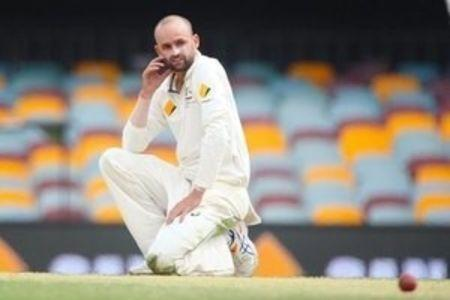 Australian bowler Nathan Lyon looks at New Zealand batsman Tom Latham, during the first cricket test match between Australia and New Zealand in Brisbane