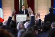 French president Francois Hollande gives a press conference to present his 2014 policy plans, on January 14, 2014 at the Elysee presidential palace in Paris
