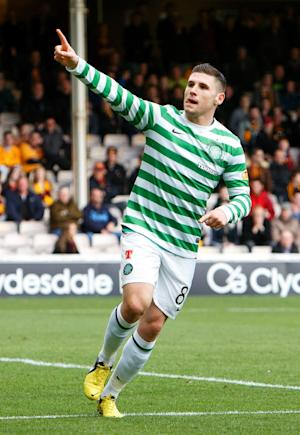 Gary Hooper has been hailed by team-mate Kris Commons and manager Neil Lennon