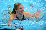 Rebecca Adlington finishes an 800m freestyle heat at last year's London Olympics. She says now is the right time to quit as she can no longer keep pace with a younger generation of swimmers